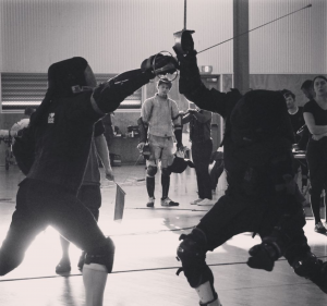 Sabre fencers swordplay